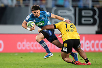 14th June 2020, Aukland, New Zealand;  Blues 1st-five Otere Black breaks a tackle during the Investec Super Rugby Aotearoa match, between the Blues and Hurricanes held at Eden Park, Auckland, New Zealand.
