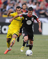 D.C. United forward Chris Pontius (13) goes against Columbus Crew midfielder Justin Meram (9)  D.C. United defeated The Columbus Crew 1-0 at RFK Stadium, Saturday August 4, 2012.