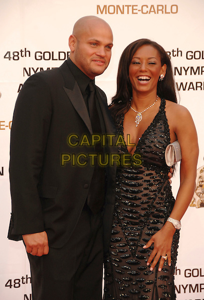 STEPHEN BELAFONTE & MELANIE BROWN.At the Golden Nymph awards ceremony during the 2008 Monte Carlo Television Festival held at Grimaldi Forum, Monte Carlo, Principality of Monaco, .June 12, 2008..half length Mel B scary spice girl black beaded dress maxi long cleavage married husband wife suit.CAP/TTL.©TTL/Capital Pictures