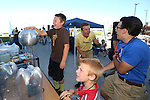 Zach Kitht, 10, plays tag with Santiago Hyslop, center, and Nick Murdakes while touching a static generator during the Journey of Hope event at Western Nevada College in Carson City, Nev., on Friday, June 12, 2015. Nearly 30 cyclist rode into town Friday as part of the Pi Kappa Phi fraternity&rsquo;s cross-country ride to bring awareness and support to people with disabilities.<br /> Photo by Cathleen Allison/Nevada Photo Source