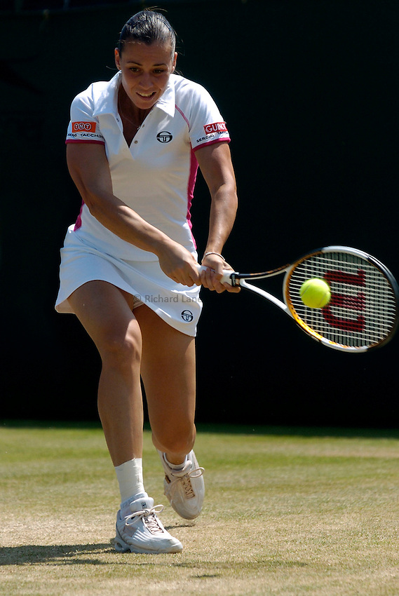 Photo: Richard Lane..Wimbledon Championships. 03/07/2006. .Flavia Pennetta of Italy returns.