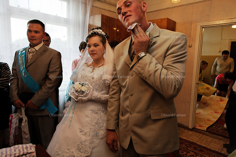 The first event of the three-day ceremony is the wedding ceremony itself at the small town hall. The groom wipes sweat off his face just before saying &quot;I do.&quot; <br /> Bride  is Miroslava Osipova.  Groom is Ivan Osipova. Best man is Leonid Petukhov.<br /> ALL ARE RELEASED.....