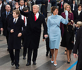 United States President Donald Trump, First Lady Melania Trump, and son, Barron Trump walk in their inaugural parade after being sworn-in as the 45th President in Washington, D.C. on January 20, 2017.    <br /> Credit: Kevin Dietsch / Pool via CNP