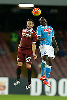 Napoli's Kalidou Koulibaly  and Fabio Quagliarella  of Torino jump f during the  italian serie a soccer match,between SSC Napoli and Torino      at  the San  Paolo   stadium in Naples  Italy , January 07, 2016