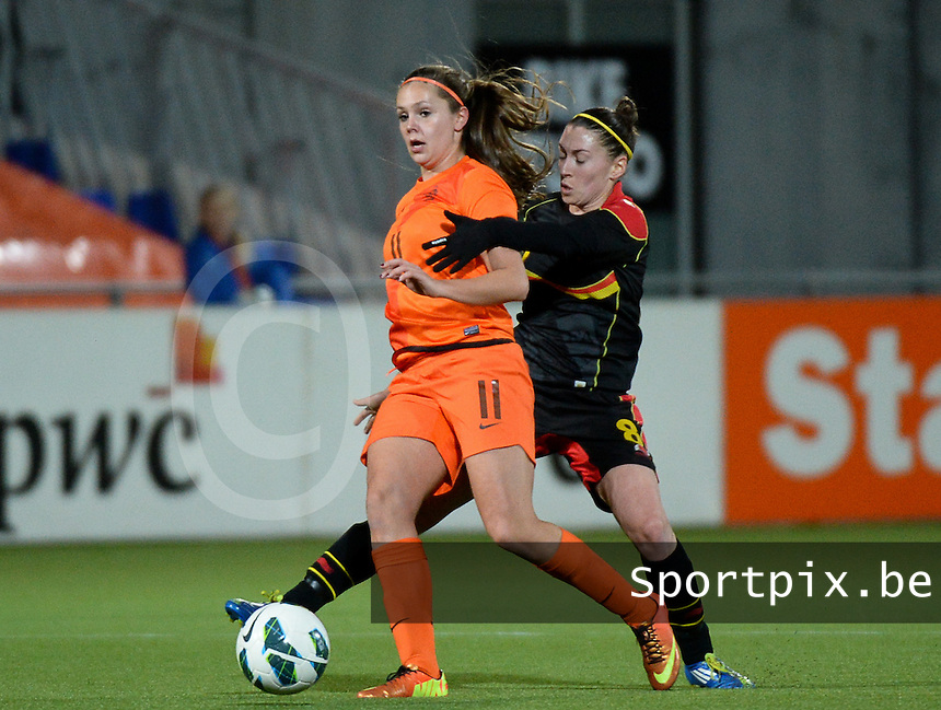 20140212 - ZWOLLE , THE NETHERLANDS : Dutch Lieke Martens (11) pictured with Belgian Audrey Demoustier (8) during the female soccer match between The Netherlands and Belgium , on the fifth matchday in group 5 of the UEFA qualifying round to the FIFA Women World Cup in Canada 2015 at Het Ijseldelta Stadion , Zwolle . Wednesday 12th February 2014 . PHOTO DAVID CATRY