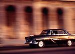 Vintage car driving, blurred motion