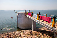 Two boys jump into the Jargu dam which irrigates farms in 59 surrounding villages in Uttar Pradesh, India.