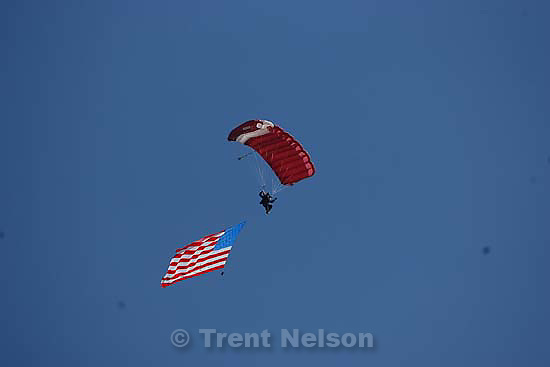Salem - Salem High School's first ever graduation ceremony, Wednesday May 27, 2009.skydiver with american flag