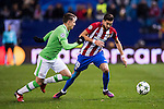 Yannick Ferreira Carrasco of Atletico de Madrid battles for the ball with Santiago Arias of PSV Eindhoven during their 2016-17 UEFA Champions League match between Atletico de Madrid and PSV Eindhoven at the Vicente Calderón Stadium on 23 November 2016 in Madrid, Spain. Photo by Diego Gonzalez Souto / Power Sport Images