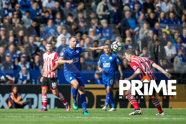 Danny Drinkwater of Leicester City passes under pressure from Pierre-Emile Hojbjerg of Southampton during the Premier League match between Leicester City and Southampton at the King Power Stadium, Leicester, England on 2 October 2016. Photo by Andy Rowland.