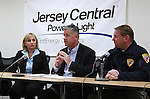 Jersey Central Power & Light President James V. Fakult (C) briefs the media with Acting Governor Kim Guadango (L) and Monmouth County Sheriff Shaun Golden (R) on Winter Storm Jonas preparations in Union Beach, New Jersey on Friday January 22, 2016.