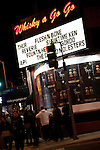 People standing in line outside Whisky A Go Go live music club in West Hollywood, CA