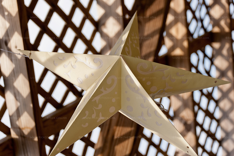 A decorative star hangs from the shading latticework above the patio at Hillsborough Vineyards.