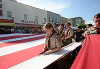 NWA Democrat-Gazette/CHARLIE KAIJO (Center) Ruby Ann Freeman, 10, of Cub Scout pack 121 helps retire a flag during the First Friday event, Friday, July 6, 2018 at the Downtown Square in Bentonville. <br /><br />The public was invited to attend the American Past Times themed First Friday event which included food trucks, a barbershop quartet, a bike race and a flag retirement ceremony led by area Boy Scout troops.