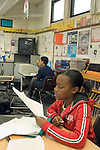 Union City CA 8th grade boy reviewing her written work before submitting it