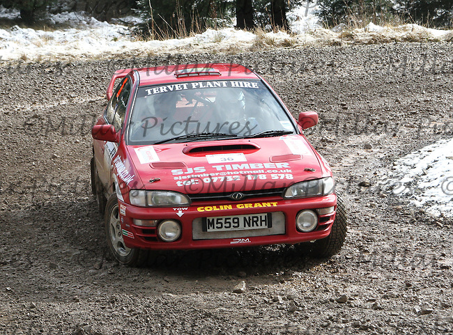 Colin Grant - Mike Cruikshank in a Subaru Impreza at Junction 6 on Special Stage 1 Riccarton on the Brick & Steel Border Counties Rally 2014, Round 2 of the RAC MSA Scottish Rally Championship sponsored by ARR Craib Transport Limited and other championships  and organised by Whickham & District and Hawick & Border Car Clubs and based in Jedburgh and held in Kielder Forest on 22.3.14.