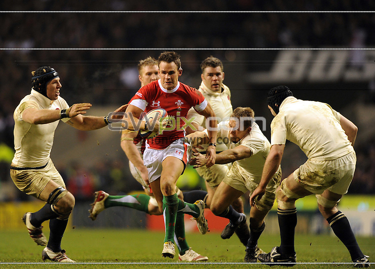PICTURE BY JEREMY RATA/SWPIX.COM. RBS 6 Nations Rugby Union International- England v Wales, Twickenham, London, England. 6th February 2010. England's Jonny Wilkinson tries to stop  Wales's Lee Byrne..Copyright - Simon Wilkinson - 07811267706