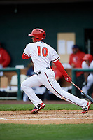 Harrisburg Senators left fielder Juan Soto (10) follows through on a swing during the first game of a doubleheader against the New Hampshire Fisher Cats on May 13, 2018 at FNB Field in Harrisburg, Pennsylvania.  New Hampshire defeated Harrisburg 6-1.  (Mike Janes/Four Seam Images)
