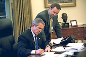 United States President George W. Bush works on a press statement with Principal Deputy White House Press Secretary Scott McClellan in the Oval Office November 7, 2002. President Bush announced on June 20, 2003  that he will name Scott McClellan to be Assistant to the President and White House Press Secretary. Currently, Mr. McClellan is Deputy Assistant to the President and the Principal Deputy White House Press Secretary. He will succeed current White House Press Secretary Ari Fleischer, who has announced that he will depart the White House in July, 2003. <br /> Mandatory Credit: Eric A. Draper / White House via CNP