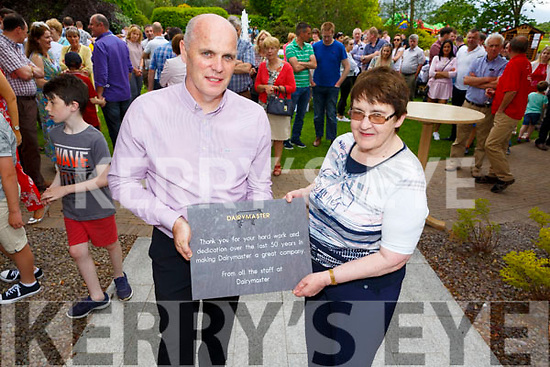 Fergus O'Mara has just presented to Mary Harty for 50 years of dedication to the company.