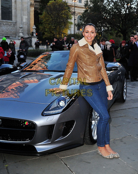 Jessica Ennis.Olympic heroine poses for pictures to launch her involvement with the Lord Mayor's Show on November 10, where she will drive an F type Jaguar, accompanied by an E type Jaguar,  as part of the parade. Grange St Paul's Hotel, London, United Kingdom..1st November 2012..full length jeans brown tan leather jacket ballet flats flat shoes sheepskin collar pumps leaning on car .CAP/BF.©Bob Fidgeon/Capital Pictures.