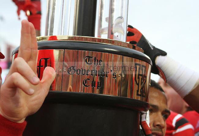 The University of Louisville Cardinal football team celebrates after winning the Governor's Cup on Sunday, Sept. 2, 2012 in Papa John's Stadium in Louisville, Ky. Louisville won 32-14. Photo by Latara Appleby | Staff