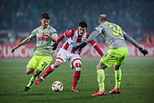 7th December 2017, Rajko Mitic Stadium, Belgrade, Serbia, UEFA Europa League football, Red Star Belgrade versus FC Cologne; Midfielder Slavoljub Srnic of Red Star Belgrade challenges Defender Konstantin Rausch of FC Koeln and Midfielder Salih Ozcan of FC Koeln