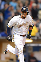 Milwaukee Brewers outfielder Carlos Gomez #27 looks to the dugout after hitting a home run during a game against the Minnesota Twins at Miller Park on May 27, 2013 in Milwaukee, Wisconsin.  Minnesota defeated Milwaukee 6-3.  (Mike Janes/Four Seam Images)
