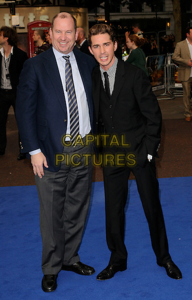GUEST & SHIA LaBEOUF.'Transformers: Revenge of the Fallen' UK film premiere at Odeon cinema, Leicester Square, London, England. .15th June 2009 .2 two full length black suit hand in pocket LaBoeuf La Boeuf waistcoat mouth open funny face .CAP/CAN.©Can Nguyen/Capital Pictures.