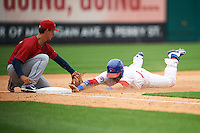 Buffalo Bisons outfielder Caleb Gindl (15) slides safely into third as Zach Walters (27) fields the throw during a game against the Columbus Clippers on July 19, 2015 at Coca-Cola Field in Buffalo, New York.  Buffalo defeated Columbus 4-3 in twelve innings.  (Mike Janes/Four Seam Images)