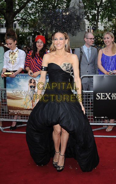 SARAH JESSICA PARKER in Alexander McQuen dress and Philip Treacey hat.'Sex And The City 2' European Premiere at the Odeon, Leicester Square, London, England..May 27th, 2010.full length sjp head piece strapless dress train gown lace puffball hem silk gown black.CAP/BEL.©Tom Belcher/Capital Pictures.