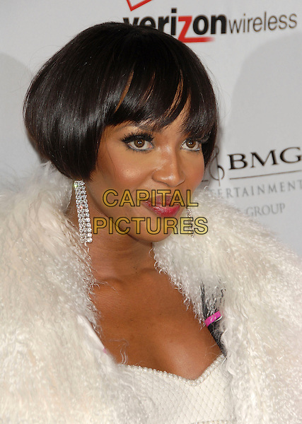 NAOMI CAMPBELL .attends The Clive Davis Pre-Grammy Party .held at The Beverly Hilton Hotel in Beverly Hills, California, USA,  February 10 2007..portrait headshot fringe bob white dress fluffy fur wrap jacket shawl.CAP/DVS.©Debbie VanStory/Capital Pictures