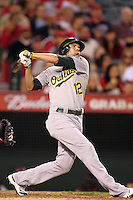 Oakland Athletics outfielder David DeJesus #12 bats against the Los Angeles Angels at Angel Stadium on September 24, 2011 in Anaheim,California. Los Angeles defeated Oakland 4-2.(Larry Goren/Four Seam Images)