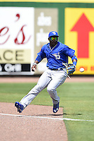 Dunedin Blue Jays outfielder Dwight Smith Jr. (25) chases down a base hit during a game against the Clearwater Threshers on April 6, 2014 at Bright House Field in Clearwater, Florida.  Dunedin defeated Clearwater 5-2.  (Mike Janes/Four Seam Images)