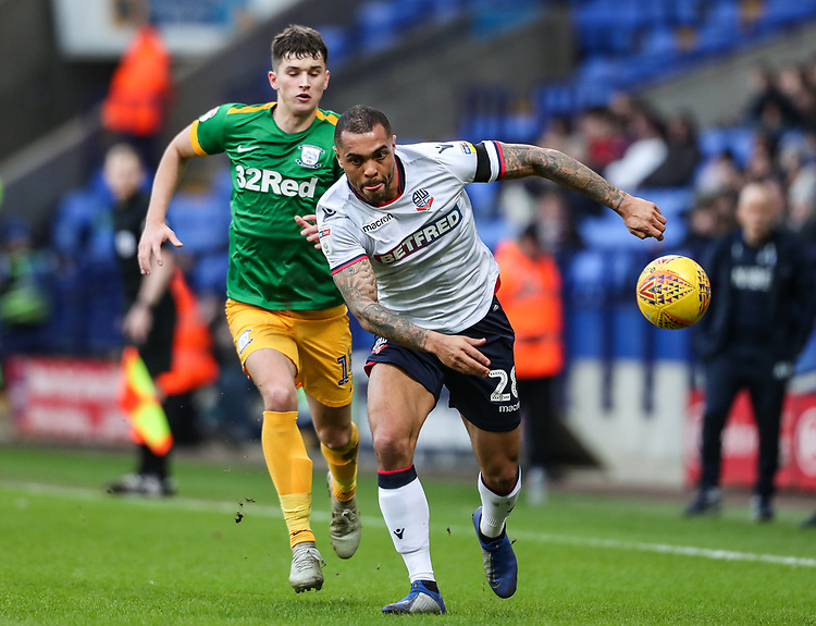 Bolton Wanderers' Josh Magennis breaks away from Preston North End's Jordan Storey  <br /> <br /> Photographer Andrew Kearns/CameraSport<br /> <br /> The EFL Sky Bet Championship - Bolton Wanderers v Preston North End - Saturday 9th February 2019 - University of Bolton Stadium - Bolton<br /> <br /> World Copyright © 2019 CameraSport. All rights reserved. 43 Linden Ave. Countesthorpe. Leicester. England. LE8 5PG - Tel: +44 (0) 116 277 4147 - admin@camerasport.com - www.camerasport.com