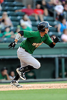 Shortstop JC Rodriguez (6) of the Savannah Sand Gnats, bats in a game against the Greenville Drive on Sunday, July 5, 2015, at Fluor Field at the West End in Greenville, South Carolina. Savannah won, 8-6. (Tom Priddy/Four Seam Images)