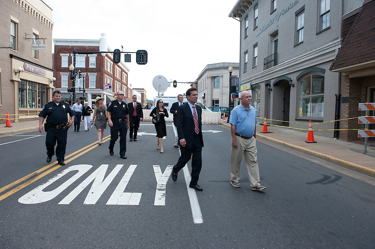 UNITED STATES - August 24 : Eric Cantor, R-VA., checks damage in downtown Culpeper Virginia along with town officials. The damage from the earthquake was substantial with lots of streets and businesses are closed. The Mayor of Culpeper Virginia Chip Coleman is in the blue shirt frame right.(Photo By Douglas Graham/Roll Call)