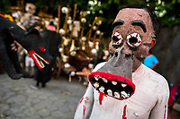 A Salvadoran boy, wearing a mask, performs an indigenous mythology character in the La Calabiuza parade at the Day of the Dead festivity in Tonacatepeque, El Salvador, 1 November 2016. The festival, known as La Calabiuza since the 90s of the last century, joins Salvador's pre-Hispanic heritage and the mythological figures (La Sihuanaba, El Cipitío, La Llorona etc.) collected from the whole Central American region, together with the catholic All Saints Day holiday and its tradition of honoring the dead relatives. Children and youths only, dressed up in scary costumes and carrying painted carts, march from the local cemetery to the downtown plaza where the party culminates with music, dance, drinking and eating pumpkin (Ayote) with honey.