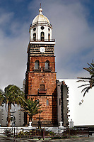 Low angle view of Church of Nuestra Senora de Guadalupe, San Miguel Plaza, Teguise, Lanzarote, Canary Islands, Spain, pictured on November 27, 2010 in the afternoon. Constructed in the first half of the 16th Century the church has a tall bell tower made from volcanic rock and topped by an octagonal belfry. Lanzarote, the Easternmost of the Canary Islands, lies 125km East of the African coast, in the Atlantic Ocean. Like the other islands in this autonomous Spanish archipelago, Lanzarote is originally Volcanic. Picture by Manuel Cohen.