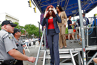 Tomi Rae Hynie, long-time partner of James Brown, walks off a stage after her husband was the guest starter of the 2006 Ford Tour de Georgia pro cycling race in Augusta, Ga. on Tuesday, April 18, 2006. James Brown died in Atlanta on Monday, Dec. 25.