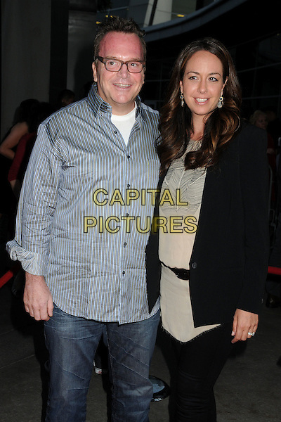 "Tom Arnold & Ashley Groussman.""Sons Of Anarchy"" Season 4 Premiere Screening held at the Cinerama Dome, Hollywood, California, USA..August 30th, 2011.half length white blue stripe shirt glasses  black beige jacket marries husband wife .CAP/ADM/BP.©Byron Purvis/AdMedia/Capital Pictures."