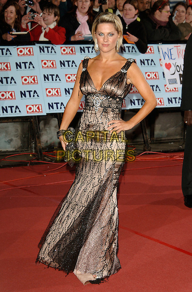 GEORGINA BOUZOVA.The National Television Awards 2006 held at the Royal Albert Hall, London, UK. - Arrivals.October 31st, 2006.Ref: PL.full length hand on hip black lace dress.www.capitalpictures.com.sales@capitalpictures.com.©Phil Loftus/Capital Pictures
