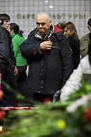 Moscow, Russia, 30/03/2010..A commuter crosses himself at a makeshift shrine on the spot inside Park Kultury metro station where a female suicide bomber blew herself up the previous day. At least 39 people were killed and 80 injured in the double blasts at Moscow metro stations during the morning rush hour.