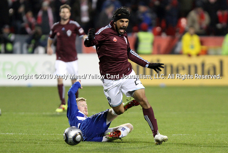 21 November 2010: Colorado's Pablo Mastroeni (25) steps over Dallas' Dax McCarty (below). The Colorado Rapids defeated FC Dallas 2-1 in overtime at BMO Field in Toronto, Ontario, Canada in MLS Cup 2010, Major League Soccer's championship game.
