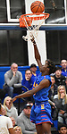 Roxana player Paris White goes in for a layup. Alton Marquette played Roxana in the Class 2A Roxana boys basketball regional final at Roxana High School in Roxana, Illinois on Friday February 28, 2020. <br /> Tim Vizer/Special to STLhighschoolsports.com
