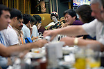 "Customers enjoy dinner and a chat with a geisha aboard a ""Yakata-bune"" pleasure boat run by Harumiya Co. in Tokyo, Japan on 30 August  2010. Photographer: Robert Gilhooly"