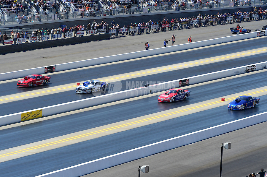 Apr. 14, 2012; Concord, NC, USA: NHRA pro stock drivers (left to right) Grace Howell , Allen Johnson , Shane Gray and Kurt Johnson race four wide during qualifying for the Four Wide Nationals at zMax Dragway. Mandatory Credit: Mark J. Rebilas-