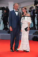 Anna Mouglalis and a gest arrives at the Award Ceremony of the 74th Venice Film Festival at Sala Grande on September 9, 2017 in Venice, Italy. <br /> CAP/GOL<br /> &copy;GOL/Capital Pictures