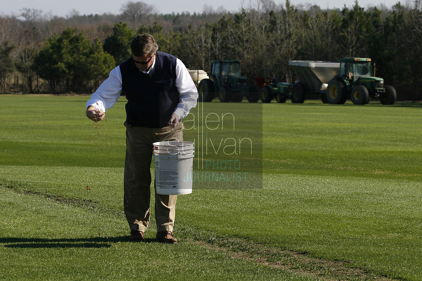 Phillip Jennings (cq), owner of Jennings Turf Farms, seeds spots in a field of turf in Riddleville, Ga. on Thursday, Dec. 28, 2006. About 100,000 square feet of the turf will be trucked to Miami to be used for the Super Bowl game.
