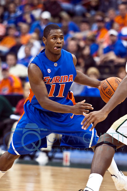 December 04, 2009:    Florida guard Erving Walker (11) during  non-conference action between the Jacksonville Dolphins and the Florida Gators at Veterans Memorial Arena in Jacksonville, Florida.  Florida defeated Jacksonville 85-67.